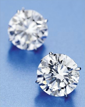 2 Round Diamonds with platinum mountings