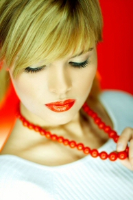 girl with coral necklace